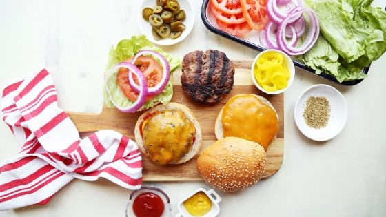 A fine summer hamburger dinner displayed
